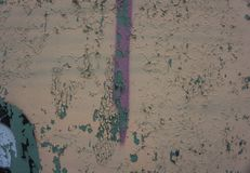 Biege and Gray Dirty Plaster Wall, With Falling Off Flakes Of Paint. Rough Surface. Old Weathered Painted Background Texture. Vint stock photography