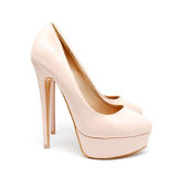 Biege high heel woman shoes isolated Stock Images