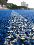 biegnij niebieski ślad sportowe Fotografia Royalty Free