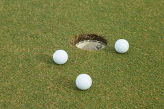 3 biel golf na zieleni Obrazy Royalty Free