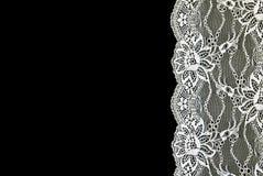 Biel koronka nad czarnym tłem. fotografia stock