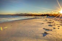 Biel plaża przy zmierzchem Obraz Stock