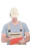 Biel usługa mężczyzna mienia klamerki Czerwona deska Zdjęcie Royalty Free