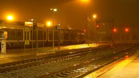 Strong night rain in the train station, Biella, Italy. Biella, Italy - April 11, 2018 - Strong night rain in the train station, Steady Trenitalia locomotives on stock video