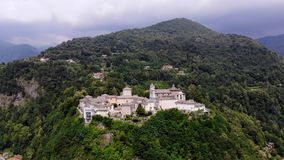 BIELLA, ITALY - JULY 7, 2018: aero View of beautiful Shrine, ancient temple complex, big castle, sanctuary located in. Mountains near the city of Biella stock footage
