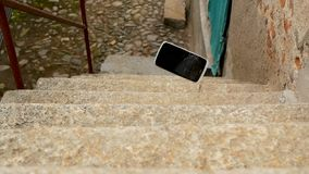 Mobile phone falls on the stairs