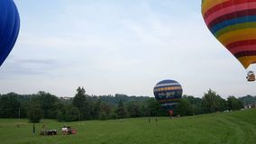 Two balloons in the landing stage. Biella, Italy, June 10, 2018 - Two hot air balloon flight and in the landing stage, June, Pollone dal Cielo, Biella stock video