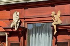 Antique buildings in Bielsko-Biala, Poland. BIELSKO-BIALA, POLAND - MAY 13, 2018: Sculptures of angels on the market in Bielsko-Biala, Poland stock photography