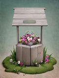 Bien, adornado con las flores Imagenes de archivo