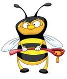 Biene mit einem Löffel Stockbilder