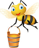 Biene mit großem Eimer Honig Lizenzfreie Stockbilder