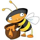 Biene mit Honig Lizenzfreie Stockfotos