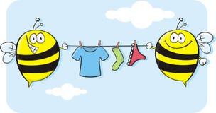 Bienen, die Wäscheleine halten! Stockfotos