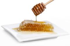 Bienenwabe auf Platte Lizenzfreie Stockbilder