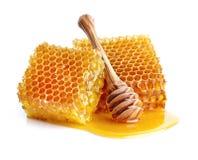 Bienenwaben mit Löffel Stockfotos