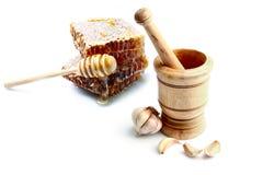 Bienenwaben-und Knoblauch-Presse Stockfoto