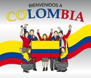 Bienvenidos a Colombia -Welcome to Colombia in Spanish language- Group of people dressed in the colors of the Colombia flag Royalty Free Stock Photography