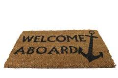 Bienvenue à bord du couvre-tapis, incliné Images stock
