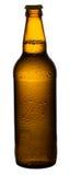 Bier in einem Braun, bernsteinfarbige Flasche Lizenzfreies Stockbild