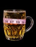 Bier met meetlint royalty-vrije stock afbeeldingen
