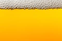 Bier met schuim Macro Royalty-vrije Stock Foto's
