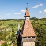Biertan town and Biertan lutheran evangelical fortified church spires and clock tower. Transylvania, Romania. Aerial close view. royalty free stock photos