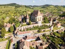 Biertan town and Biertan lutheran evangelical fortified church in Sibiu County, Transylvania, Romania. Aerial view. stock image