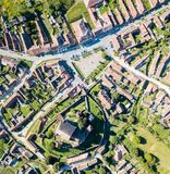 Biertan town and Biertan lutheran evangelical fortified church in Sibiu County, Transylvania, Romania. Aerial view. stock photography