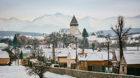Biertan village during the winter time. The Romanian traditional village Biertan in the winter with a great view to the mountains Stock Photography