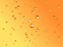 Biertropfen des orange backgroun Stockbilder