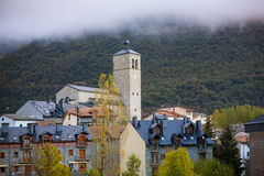 Biescas village in Huesca Aragon Pyrenees of Spain. In foggy morning Royalty Free Stock Photos