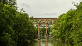 Bietigheim viadukt time lapse. Beautiful time lapse shot of the Bietigheim-Bissingen city park and its iconic railway viaduct and the river Enz below it stock video footage