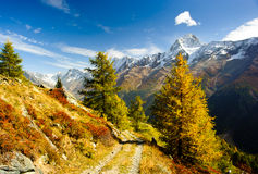 Bietschorn mountain peak in autumn with hiking trail Royalty Free Stock Photo