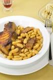 Bife da carne de porco com feijões Fotos de Stock Royalty Free