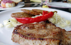 Bife da carne de porco com salmouras foto de stock