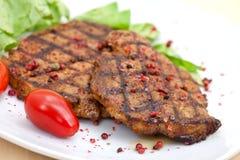 Bife da carne de porco, grelhado com salada Fotografia de Stock Royalty Free