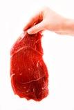 Bife de carne da terra arrendada da mão Imagem de Stock