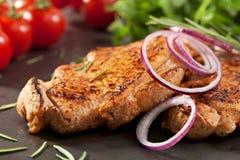 Bife do lombo de carne de porco Imagens de Stock