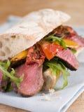 Bife do Sirloin e sanduíche Roasted de Ciabatta da pimenta imagens de stock royalty free