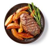 Bife e batatas grelhados fotografia de stock royalty free
