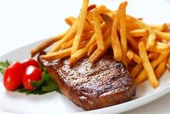 Bife e fritadas Imagem de Stock