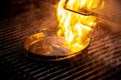 Bife grelhado da carne da carne e de carne de porco na frigideira Imagem de Stock Royalty Free