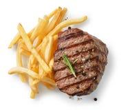 Bife grelhado e batatas fritadas imagem de stock royalty free