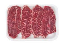 Bife superior sem ossos da lâmina na bandeja Imagens de Stock Royalty Free