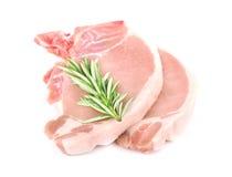 Bifes crus da carne de porco isolados Imagens de Stock Royalty Free