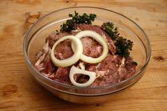 Bifes da carne de porco pstos de conserva no petróleo Imagens de Stock