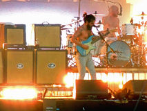 Biffy Clyro at the Isle of Wight Festival. Biffy Clyro singing and playing guitar on the Main Stage at the Isle of Wight Festival in June 2014 Royalty Free Stock Photography