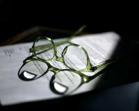 Bifocals on papers Royalty Free Stock Photos