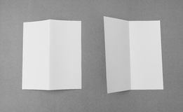 Bifold white template paper on gray  background . Stock Image