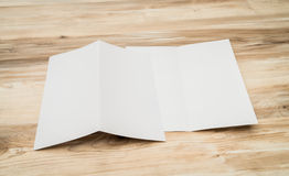 Bifold white template paper on wood texture. Stock Images